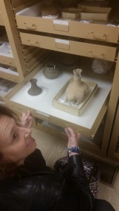 An attendee examines items in the Moundville Archeological Park's Special Collections holdings.