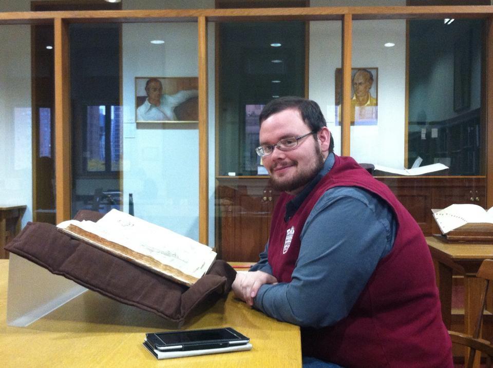 Ed Gray sits in a Paris archive, reading a manuscript.