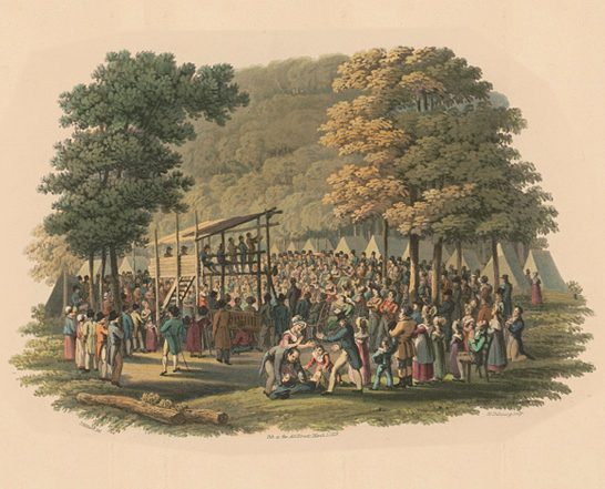 people gathered in a public green space