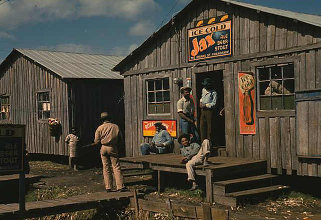 African American men gathered outside a store