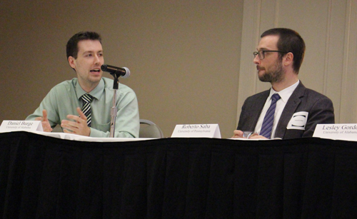 This is an image of Daniel Burge (left) and Roberto Saba (right) on the dais.