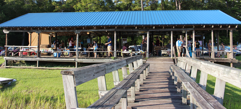 This image shows the Tuscaloosa Sailing Club pavilion and the party attendees sitting at tables.