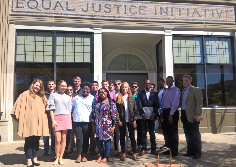This image shows students, along with Dr. Giggie, standing outside the EJI office in Montgomery, AL.
