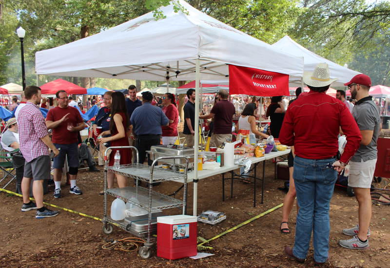 This image shows people mingling at the tailgate.