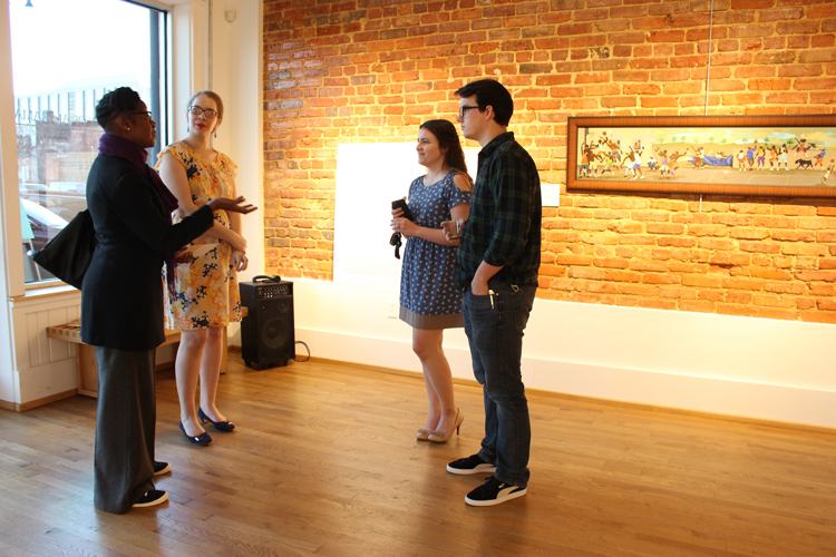 Sharony Green talking with students at the art gallery
