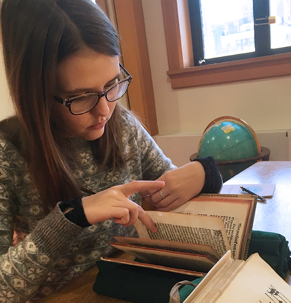 a student reading an old book
