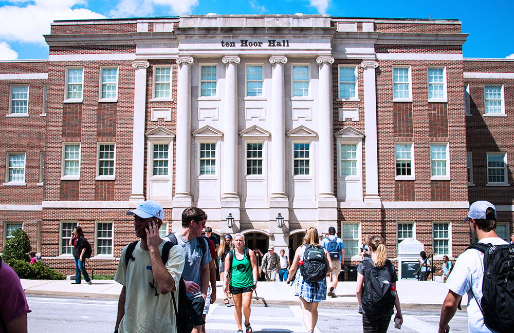 students walking in front of ten Hoor Hall