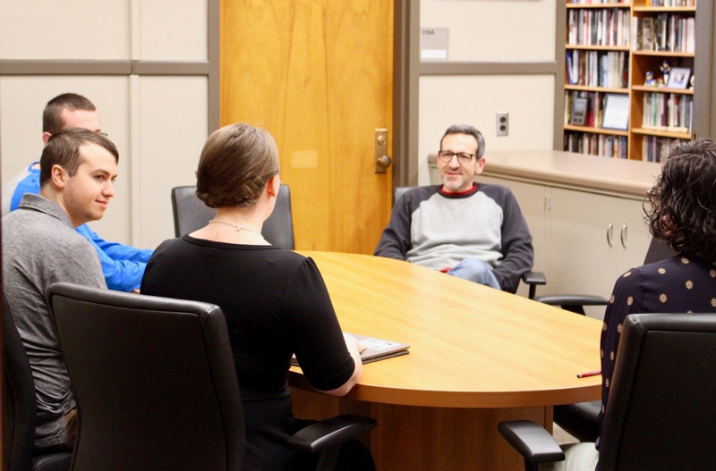 Josh Rothman meets with prospective students.
