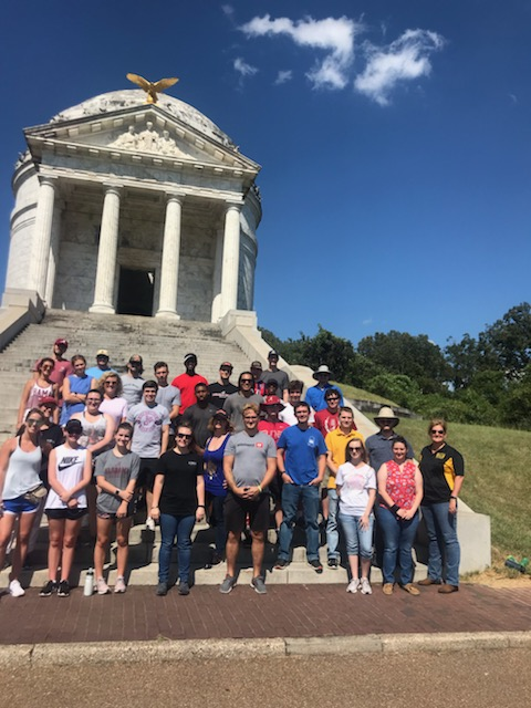 Image showing students on the steps of the enormously large Illinois monument at the Vicksburg National Military Park