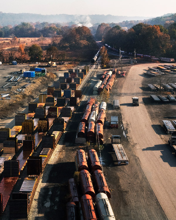 Image showing numerous train cars in a railroad yard.