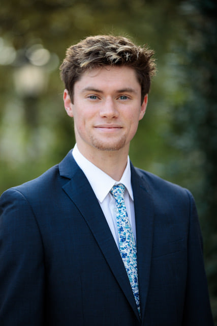 Image of Jackson Foster in a sport coat and tie.