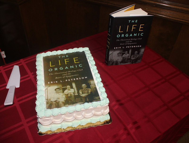 "This is a photo of Dr. Peterson's""book cake,"" a tradition in the department where we have a cake with icing on it that looks like the book cover."