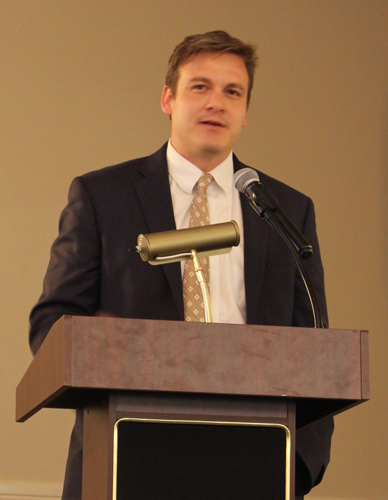 This is an image of David C. LaFevor speaking before the audience.