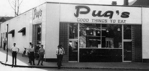This image shows Pug's Restaurant, with several customers milling about.