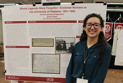Emma Pepperman in front of her poster.