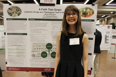 Molly Buffington in front of her poster.