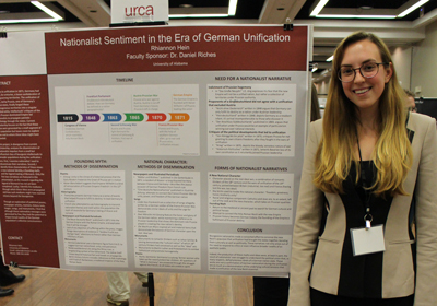 Rhiannon Hein in front of her poster.